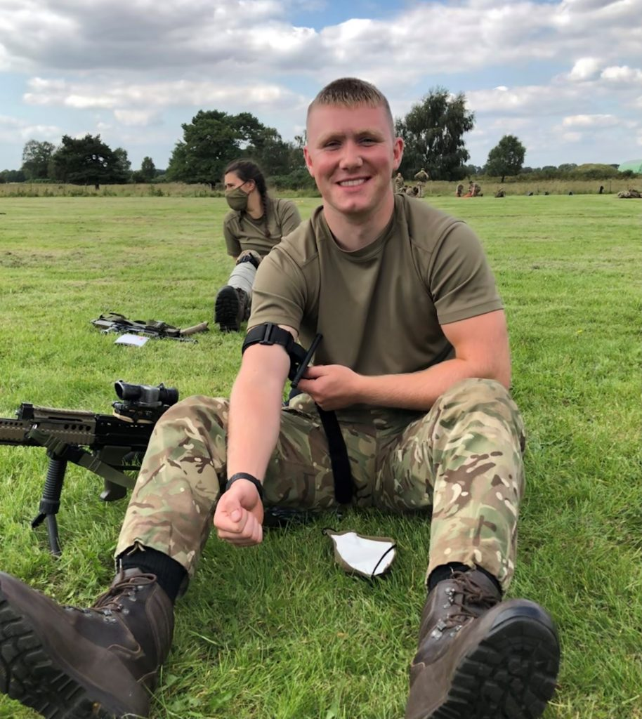 Leeds University Officer Cadet Billy Shield doing first aid training while on camp.