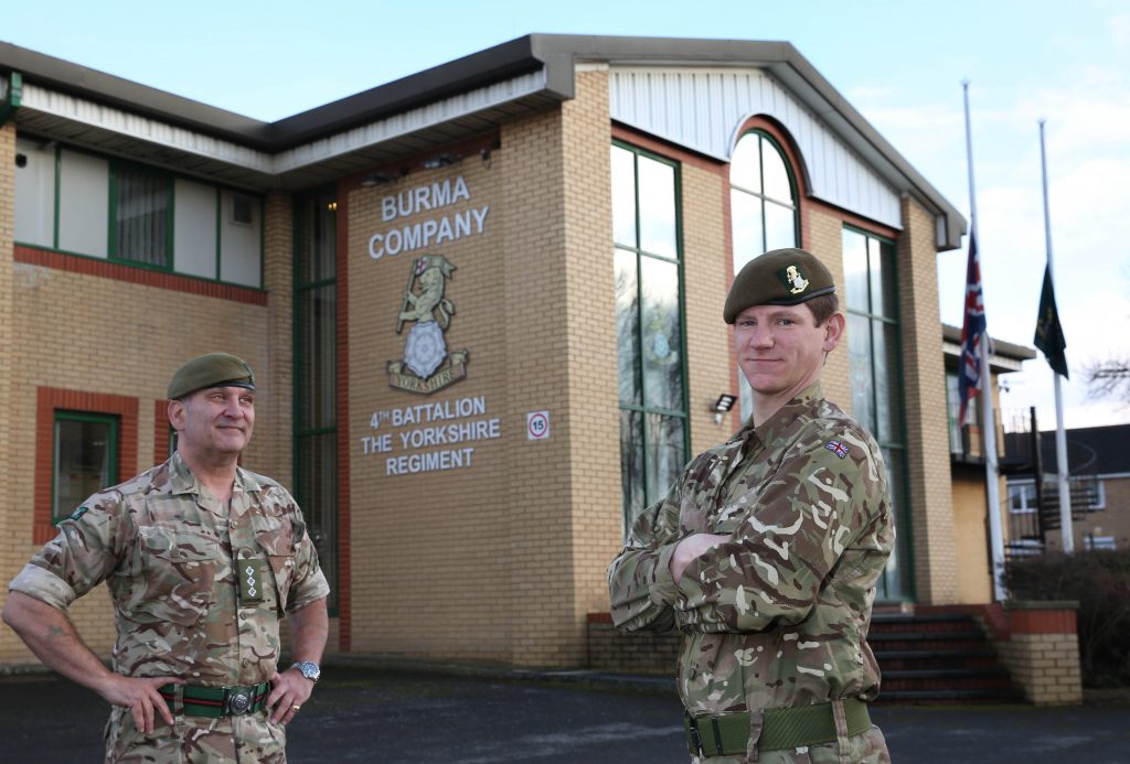 Reserve Ryan Shippey outside Burma Company's headquarters in Barnsley with a senior officer looking on.