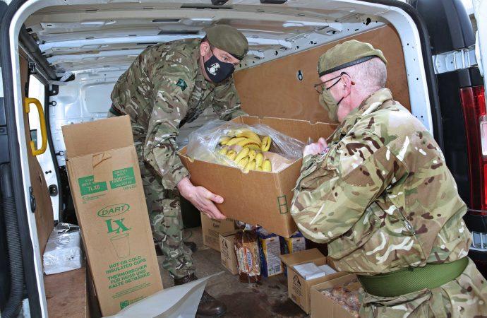 Reservists Conrad Chamberlain and Dave Midgley unload supplies