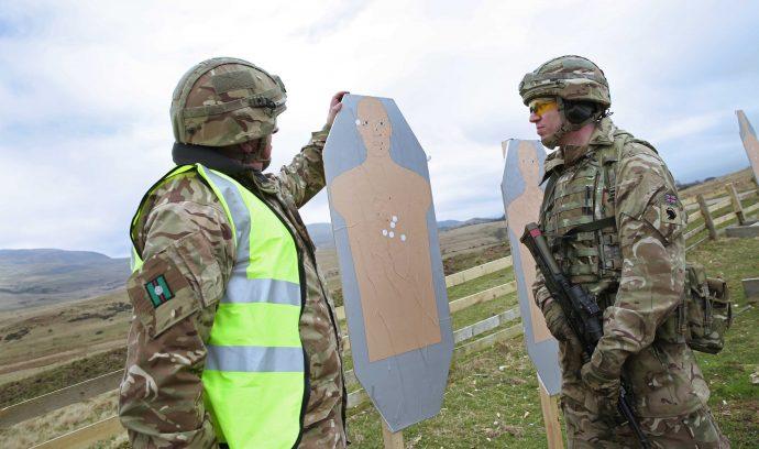 Reservist Glen Marshall and Kevin Etherington inspect target