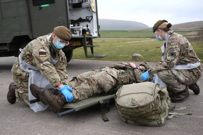 Reservists Rhoz Shutt and Kate Johnson care for a casualty