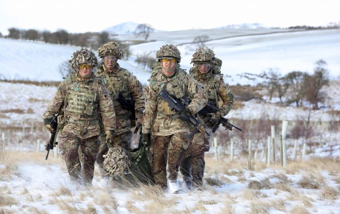 Jordan Morrison and Timothy Lambert leading a stretcher bearing party at Warcop Training Area