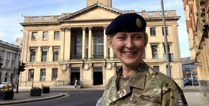 Female in front of Hull Civic Hall in army dress