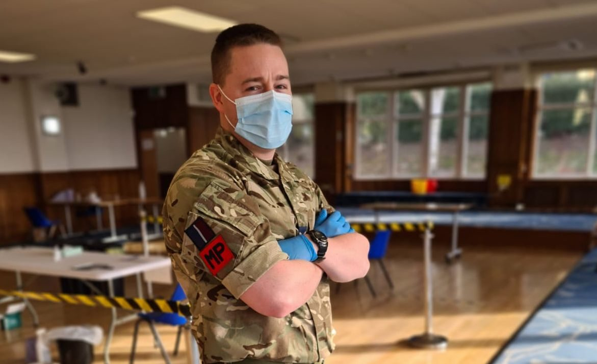 RAF reserve in face mask and rubber gloves