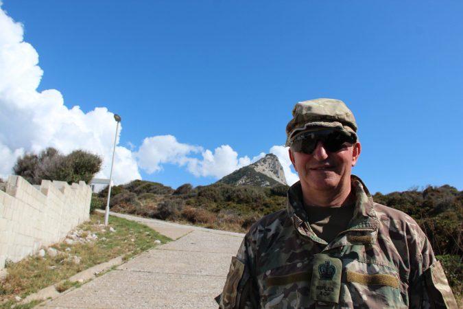adult volunteer in sunglasses against blue skies