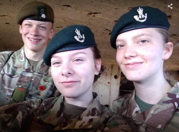 Three smiling cadets