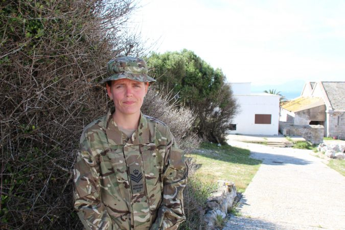 Army cadet force volunteer in combat clothing