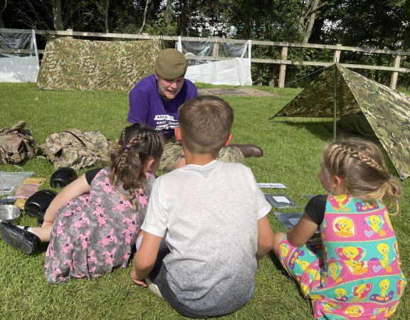 small children chat to a cadet force adult volunteer at great yorkshire show