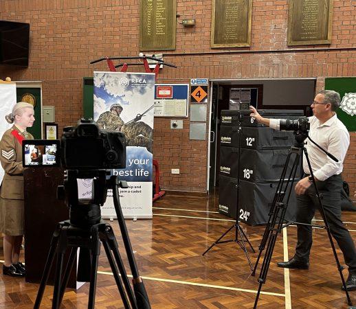 Cadet being filmed by man