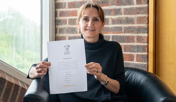 Woman holding an Armed Forces Covenant Document